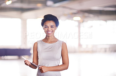 Buy stock photo Portrait of a businesswoman holding a tablet in her office