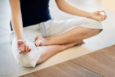 Buy stock photo Cropped shot of an unrecognizable woman meditating