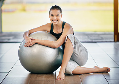 Buy stock photo Full length portrait of a young woman sitting against her exercise ball