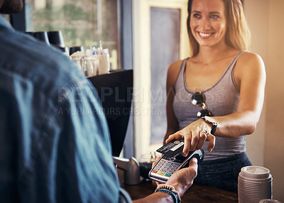 Buy stock photo Shot of a woman paying for coffee with a credit card at a cafe