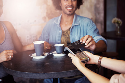 Buy stock photo Cropped shot of a man paying for coffee with a credit card at a cafe