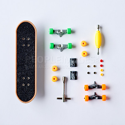 Buy stock photo High angle shot of a skateboard and accessories on a table