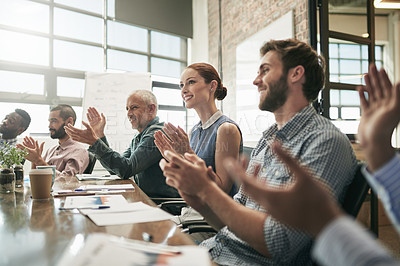 Buy stock photo Shot of a team of businesspeople clapping hands while having a meeting in an office