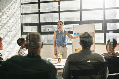 Buy stock photo Shot of a businessman giving a presentation to his colleagues