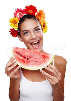 Buy stock photo Cropped portrait of a beautiful young woman wearing a crown of flowers and eating a watermelon