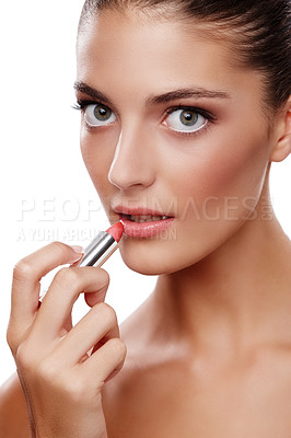 Buy stock photo Studio shot of a beautiful young woman applying lipstick isolated on white