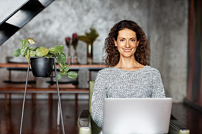 Buy stock photo Portrait of smiling woman sitting in her living room using a digital tablet