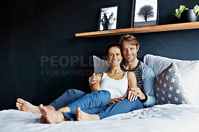 Buy stock photo Portrai of a smiling couple lying in bed together