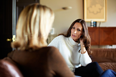 Buy stock photo Shot of a woman talking with her mother on the living room sofa