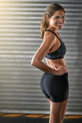 Buy stock photo Cropped portrait of a young woman working out at the gym