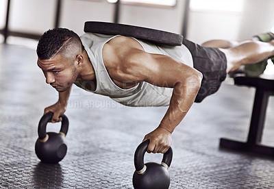 Buy stock photo Cropped shot of a young man working out in the gym
