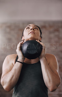 Buy stock photo Cropped shot of a young woman working out in the gym