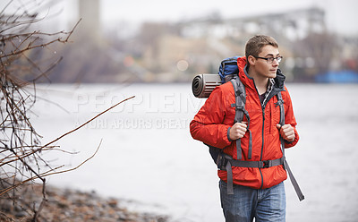 Buy stock photo Shot of a hiker taking time to admire the beautiful scenery