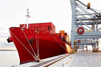 Buy stock photo Shot of a freighter waiting for cargo at a large commercial dock
