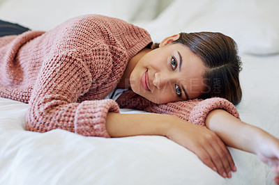 Buy stock photo Portrait of a young woman lying on her bed