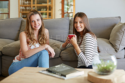 Buy stock photo Portrait of two friends sitting on the living room floor together