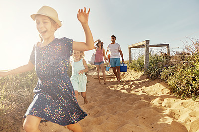 Buy stock photo Shot of a young family arriving at the beach