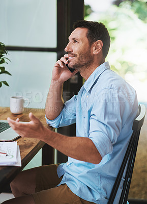 Buy stock photo Cropped shot of a businessman talking on his cellphone at home