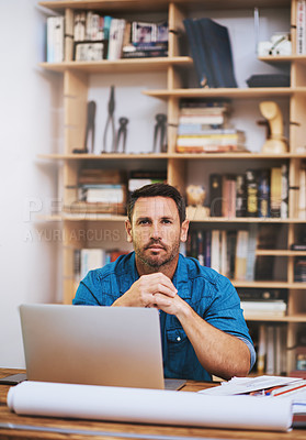 Buy stock photo Cropped portrait of a businessman working on his laptop at home