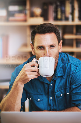 Buy stock photo Cropped shot of a businessman drinking coffee while working at home