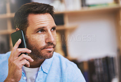 Buy stock photo Cropped shot of a businessman talking on his cellphone while working at home