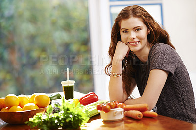 Buy stock photo Portrait of a young woman preparing a healthy meal at home
