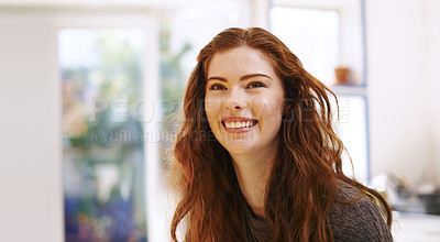 Buy stock photo Shot of a happy young woman at home