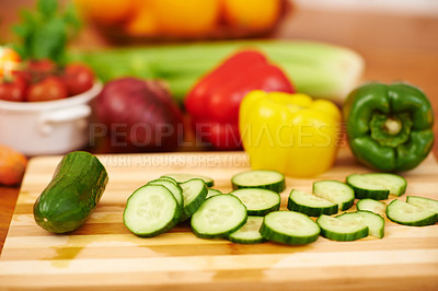 Buy stock photo Shot of freshly sliced cucmbers on a kitchen counter