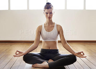 Buy stock photo Full length shot of a woman meditating indoors