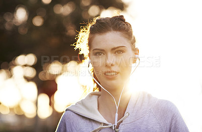 Buy stock photo Cropped shot of an attractive young woman taking an early morning jog