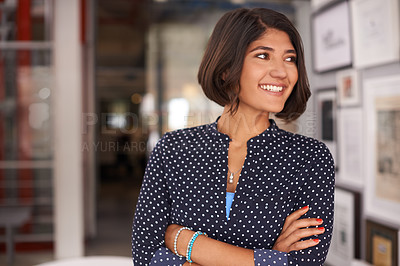 Buy stock photo Shot of an ambitious young woman working in an office