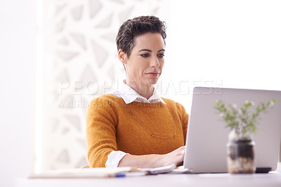 Buy stock photo Shot of a businesswoman working on her laptop at the office