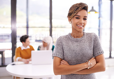 Buy stock photo Portrait of an ambitious young woman working in a modern office