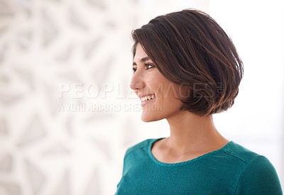 Buy stock photo Shot of an ambitious businesswoman standing in an office