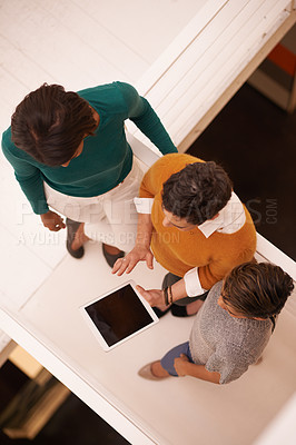 Buy stock photo High angle shot of three businesswomen working in the office