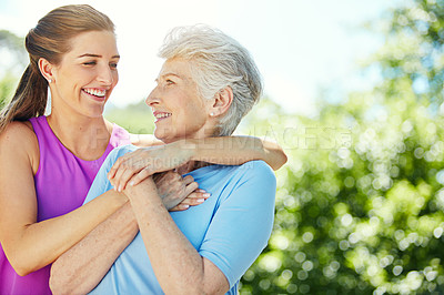 Buy stock photo Cropped shot of a young woman and her mother in the park