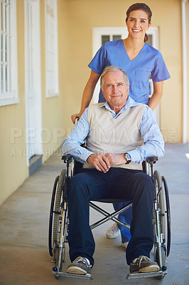Buy stock photo Shot of a doctor pushing her senior patient in a wheelchair