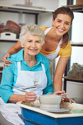 Buy stock photo Shot of a senior woman making a ceramic pot at a pottery class