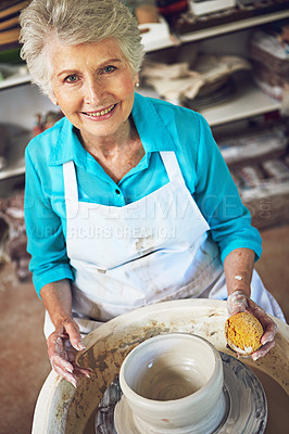Buy stock photo Portrait of a senior woman making a ceramic pot in a workshop