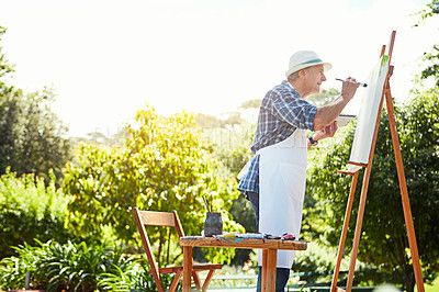 Buy stock photo Cropped shot of a senior man painting in the park