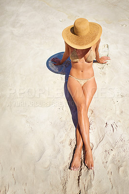Buy stock photo High angle shot of a young woman relaxing at the beach