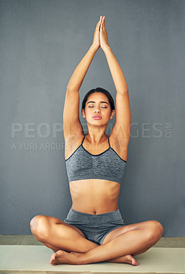Buy stock photo Full length shot of a young woman doing yoga