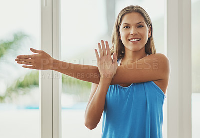 Buy stock photo Cropped portrait of a young woman practicing yoga at home