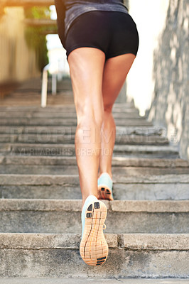 Buy stock photo Rearview shot of a female athlete exercising outdoors