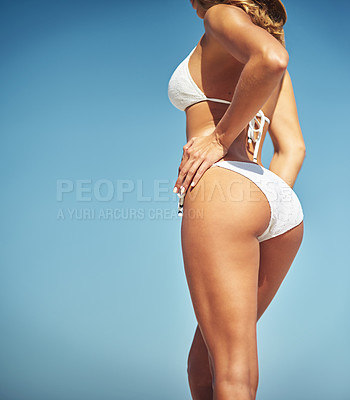 Buy stock photo Cropped shot of a gorgeous woman in a bikini at the beach