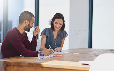 Buy stock photo Cropped shot of two businesspeople working in the office