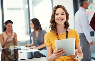 Buy stock photo Cropped portrait of a young businesswoman using her digital tablet during a meeting