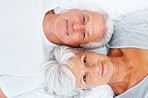 Senior couple lying together on bed