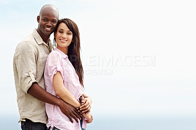 Buy stock photo Portrait of an affectionate couple enjoying a day outside together