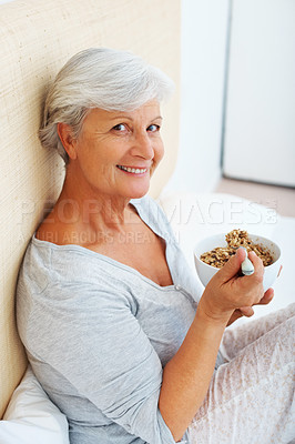Buy stock photo Portrait of senior woman smiling and looking at you while having breakfast on bed
